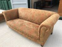 Comfortable and attractive Chesterfield styled sofa and matching armchair