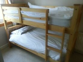 Two sets of full size pine bunk beds (total 4 beds)