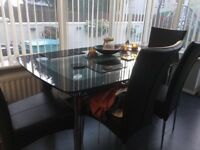 Dining table black glass four black leather chairs