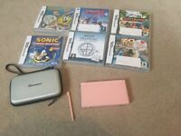 Pink Nintendo ds with 7 games
