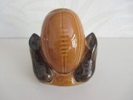 CHINA MONEY BOX SHAPED LIKE A FOOTBALL WITH BOOTS AT SIDE