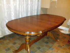 Dark polished ornate style wood oval shaped dining table
