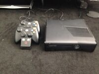 Xbox 360, 2 wireless controllers and charging station + 9 games