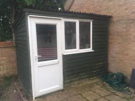 Large green shed with pvc door and window