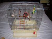 Budgie or small bird cage with toys and accessories