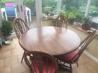 Ercol pedestal table and 4 swan back chairs