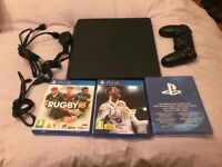 Almost new. PS4 slim 500gb.1 Controller. With fifa 18,rugby 18. £200 NO OFFERS.CAN DELIVER