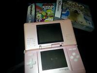 Pink Nintendo ds with two games