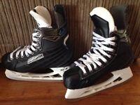 Bauber men's ice skates . Used once size 8.5ize