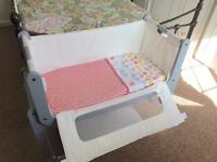 Snuzpod with girls bedding and swaddle blanket