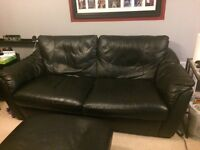 Large black IKEA leather sofa
