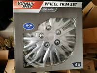 NEW SET OF WHEEL TRIMS (STILL IN THE BOX)