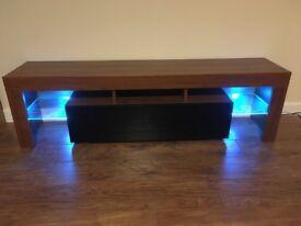 Dark brown wood grain and gloss black with glass shelfs and LED lights i