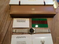 gents gucci watch, black face with diamonds.
