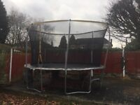Trampoline 14ft with enclosure £100 originally paid £220