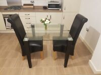 Glass Dining Table and Two Chairs