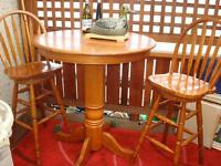 """2 Swivel high back chairs and round table 36"""" across x 41"""" high"""