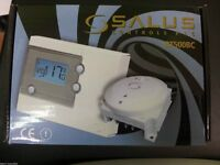 Digital programmable room thermostat