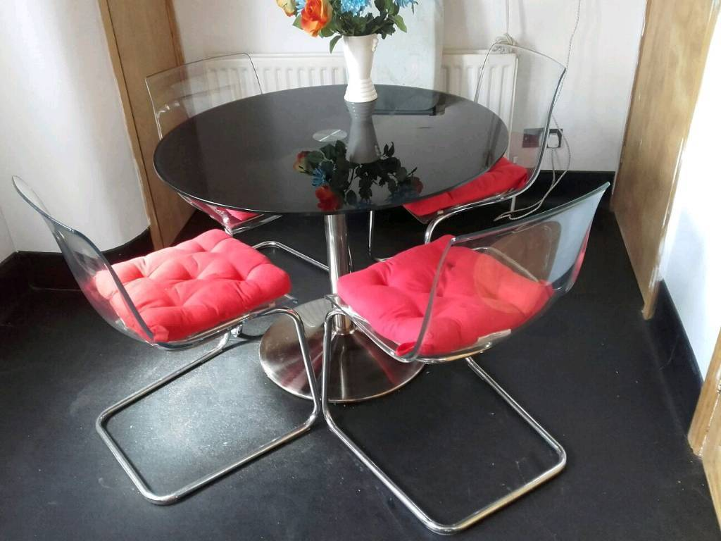 Ikea glass round dining table black and 4 bounce chairs ...