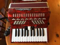 Accordion Pearl River 48 bass/26 treble with solid case