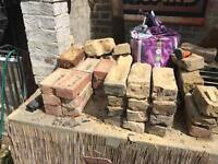 Assorted reclaimed red and yellow metric imperial bricks