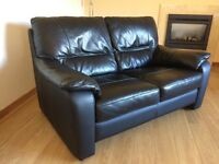 Sofa - 2 seater black leather. As new. Hardly used.
