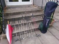 Golf clubs and bag. Righthanded lady