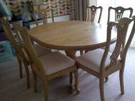 Solid sturdy quality dining table and 6 oak chairs. Extends to 6 seater.