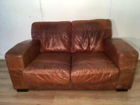 Tan 2 seater real leather sofa with free delivery within 10 miles