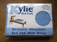 Kylie Bed Pad: Brand New washable, absorbent bed pad with wings