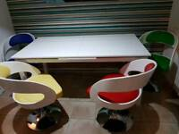 White Gloss Dining Table With Round Coloured Swivel Chairs