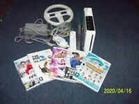white nintendo wii and games