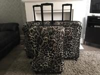 3 x large hard shell expandable suit cases