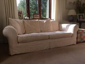 Three seater sofa. Armchair and footstool