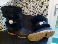 New women's black snow boots from USA cost $140, size 9