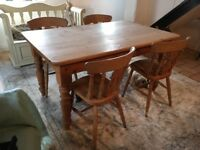 Solid pine dining table with four matching chairs. Good condition. Could maybe deliver locally.