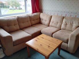 Corner L-shaped tan sofa