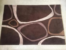 Large brown rug 120x180cm great condition swirls
