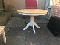 Rustic round table with 3 chairs