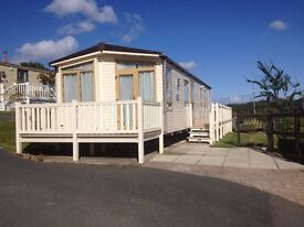 STUNNING ABI SAFFRON STATIC CARAVAN WITH DUAL ASPECT DECK ON LOVELY 12 MONTH PARK IN NORTH WALES