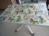 Upcycled decoupage extending Regency-style coffee table