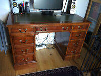 Antique reproduction desk for computer, mahogany veneer, green leather top