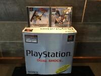 Boxed PlayStation 1 with booklets, plus 2 games