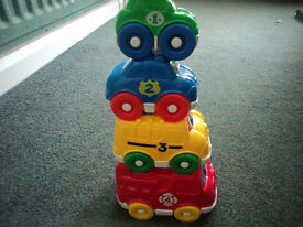Set of 4 brightly coloured stacking numbered cars which also fit inside each other.