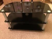 Black glass TV stand, very good condition, 71 cm wide