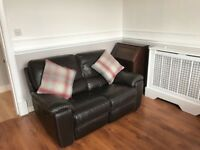 Electric reclining brown leather sofa and arm chair