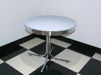 circular white and chrome American dining table