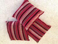 Three elegant burgundy, red and stripe decorative pillows