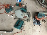 A selection of used 240VAC power tools (stapler, angle grinder, saw, router, jigsaw)