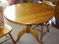 Pine round table & 4 chairs with cushions £25ono